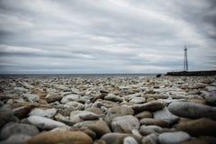 Sea. Side Toila beach stones on water Royalty Free Stock Image