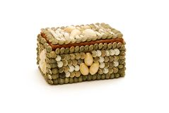 Sea Shell Box. A small box made from assorted seashells isolated against a white background Stock Images