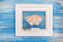Sea Shell in the frame with sign - Life is an adventure Stock Photography