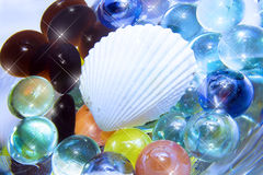 Sea shell and glass beads. White sea shell with sparkling glass beads Royalty Free Stock Photos