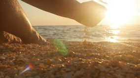 Sea shell in the hand at the beach. Summer day on beach concept. stock video footage