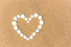 Sea shell heart on the sand beach Royalty Free Stock Photo