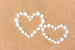 Sea shell hearts on the sand beach Stock Photography