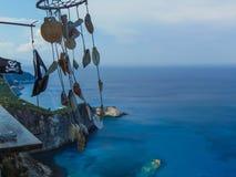 Sea shell ornaments hanging on a seaside Bar. In Lefkada Greece stock photos