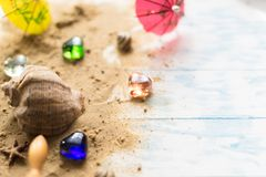 Sea shell on a wooden background with sand. Concept of summer holidays Royalty Free Stock Images