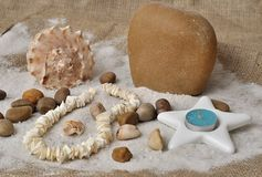Sea shells and candle composition Stock Images