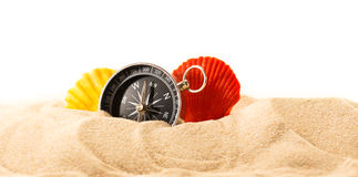 Sea shells and compass in sand Stock Photography