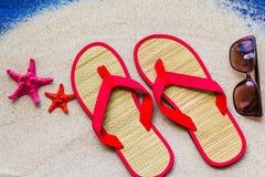 Sea shells flip flops beach sand. Sea shells and flip flops on beach sand Royalty Free Stock Photos