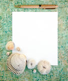 Sea Shells with Note Paper and Pen Stock Image