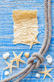 Sea shells and old paper Stock Photos
