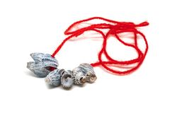 Free Sea Shells On A Red Thread Isolated On A White Background. A Handmade Gift From The Beach. Collecting Seashells On Vacation Stock Photo - 164553200