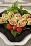 Sea shells pasta stuffed with vegetables and ham Stock Photography