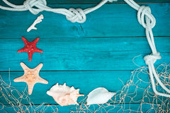 Sea shells and rope on old boards Royalty Free Stock Photos