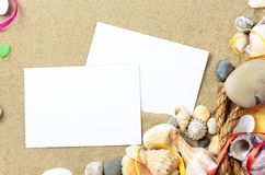 Sea shells with sand, rope and postcards as background Royalty Free Stock Photography