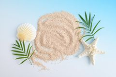 Sea shells with sand. Isolated on blue background stock photo