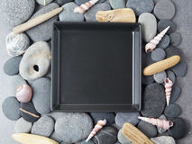 Sea shells stones frame on grey background. Top view. Flat lay Royalty Free Stock Photo
