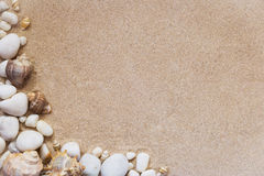 Sea shells and stones with sand as background. Sea shells and white stones with sand as background Royalty Free Stock Image