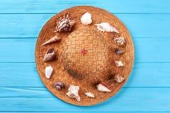 Sea shells on straw hat. stock photography