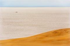 Sea, ship, dunes Royalty Free Stock Image