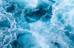 Sea ship trail with foamy wave. Tropical islands ferry travel. Cruiseliner seawater trail. Deep ocean top view. Big ship pitching image. White swirl wave on royalty free stock photo