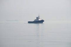 Sea Ship-tug Floats In The Mist Stock Image