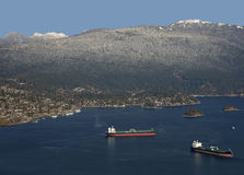 Sea with ships and mountain Stock Image