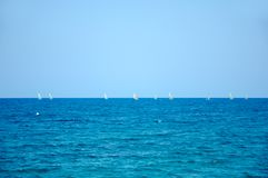Sea ships with ships sailing in the distance royalty free stock images