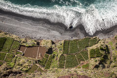 Sea Shore - Beach Top View with Green Fields. Madeira royalty free stock image