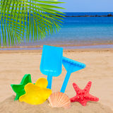 Sea shore with bright plastic beach toys Stock Photo
