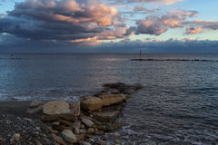 Sea shore and clouds in the sunset light. Cyprus. Limassol surroundings Stock Photo
