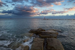 Sea shore and clouds in the sunset light. Stock Photography
