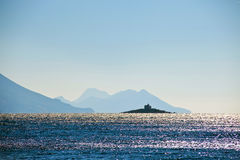 Sea shore Croatia distant lighthouse island Stock Image