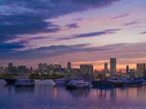 Sea Shore at Dusk. Kwun Tong sea shore a dusk. Hong Kong. There is some ships, boats and yacht on the sea in front of some residential buildings Royalty Free Stock Image