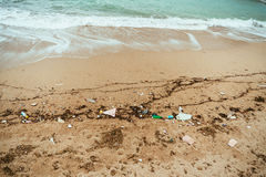 The sea shore in the garbage. Environmental pollution. Garbage o Stock Photo
