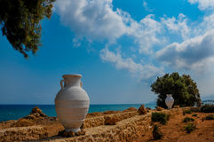 The sea shore with golden sand and a Greek vessel Royalty Free Stock Images