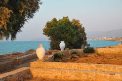 The sea shore with golden sand and a Greek vessel Stock Photo