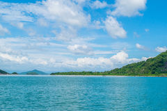 Sea shore at a paradise island with cloudy sky Stock Image