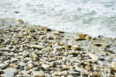 Sea shore with pebble beach Royalty Free Stock Images