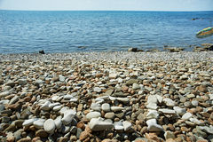 Sea shore with pebble beach Royalty Free Stock Photos