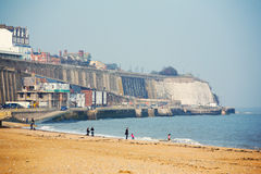Sea shore in Ramsgate. People walking on beach Stock Photos