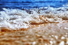 Sea shore in splashing motion Stock Image