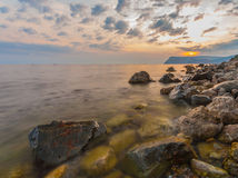 Sea, shore and stones Stock Photos