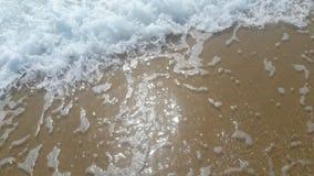 Sea shore with white foam stock photo
