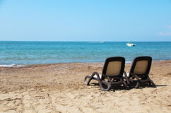 Sea shore. Wo sunbeds on the beach on the Mediterranean sea Royalty Free Stock Photography
