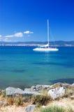 Sea shore and the yacht stock photos