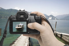 Sea shot. A hand reaches out of a digital camera Stock Image