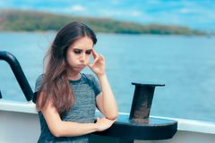 Sea sick woman suffering motion sickness while on boat. Suffering girl traveling on water and feeling fearful and unwell royalty free stock photos
