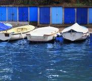 Sea side cabins. Boats on the dock, with blue sea side cabins. Opatija, Croatia stock image