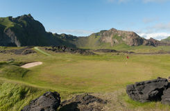 Sea side golf green in volcanic landscape Stock Image