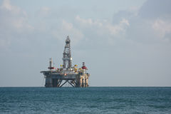 Sea side oil rig. Stock Images
